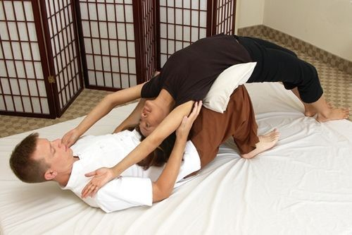 Thai massage bridge pose